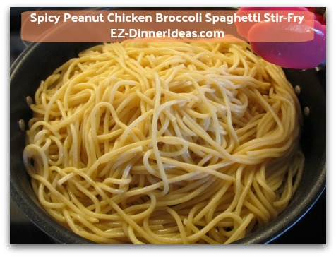 Spicy Peanut Chicken Broccoli Spaghetti Stir-Fry - Add pasta on top of cooked chicken