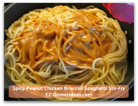 Spicy Peanut Chicken Broccoli Spaghetti Stir-Fry - Add spicy peanut sauce into pasta; toss to coat