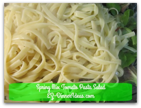 Spring Mix Tomato Pasta Salad - Top with cooked pasta