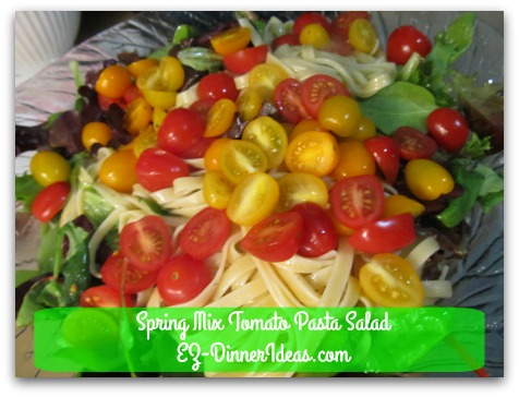 Spring Mix Tomato Pasta Salad - Top with grape tomatoes and serve immediately