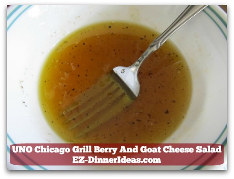 UNO Chicago Grill Berry And Goat Cheese Salad - This honey vinaigrette is the key to make the goat cheese blended so well with everything.