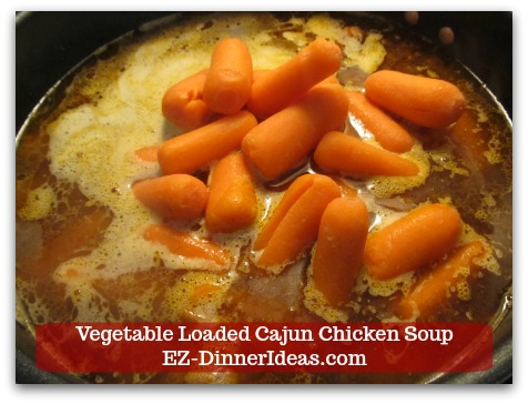 Kale Chicken Soup | Vegetable Loaded Cajun Chicken Soup - Add baby carrots and cook at low boil for 20 minutes.
