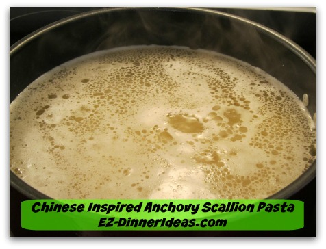 Chinese Inspired Anchovy Scallion Pasta - Bring a big pot of water to boil and stir in pasta