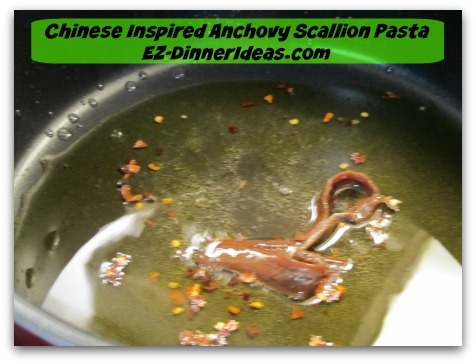 Chinese Inspired Anchovy Scallion Pasta - Add anchovy fillets/paste and stir until melted and infused oil