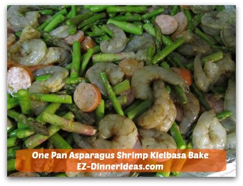 One Pan Asparagus Shrimp Kielbasa Bake - Transfer everything to an aluminum foil-lined baking sheet.  Dinner will be ready in 30 minutes.