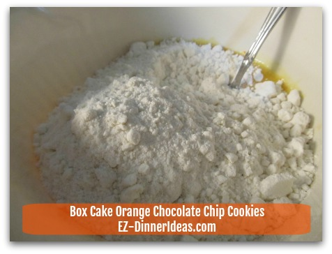 Box Cake Orange Chocolate Chip Cookies - Add dry ingredient (cake mix) into the wet ingredient