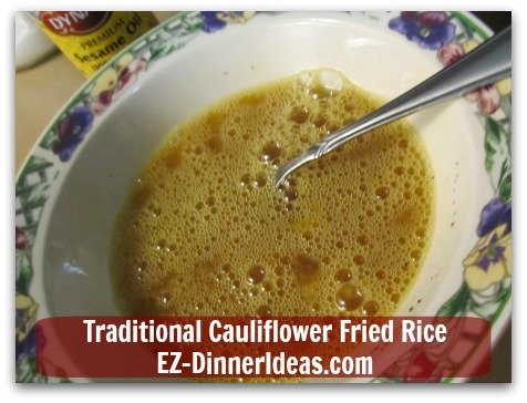 Traditional Cauliflower Fried Rice - Beat eggs with soy sauces, salt and pepper in a mixing bowl