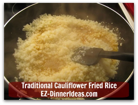 Traditional Cauliflower Fried Rice - When rice grains are hot, stir in egg mixture