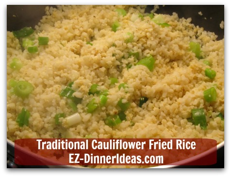 Traditional Cauliflower Fried Rice - Garnish with scallion; salt and pepper to taste and serve immediately