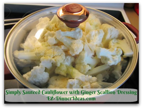 Simply Sauteed Cauliflower with Ginger Scallion Dressing - Add salt, oil, water and cover to cook at high heat