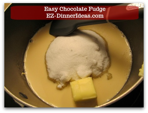 Easy Chocolate Fudge - In a medium sauce pan, combine sugar, evaporated milk, butter and salt together.