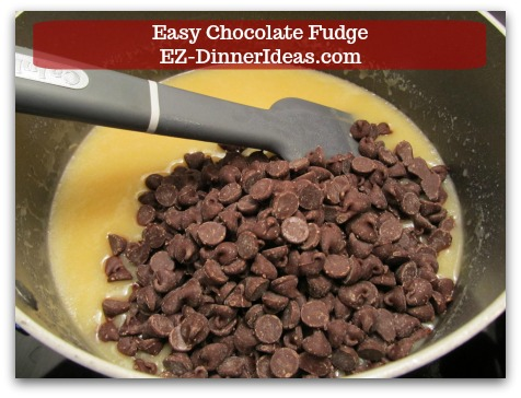 Easy Chocolate Fudge - Stir in chocolate, nuts (optional) and vanilla extract.