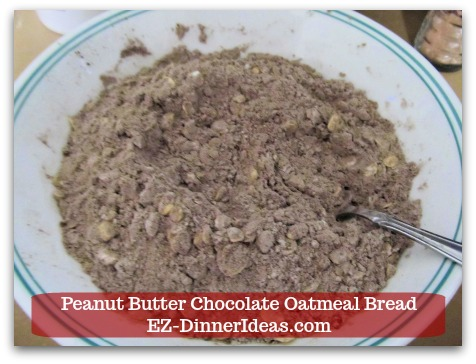 Great Breakfast Idea | Peanut Butter Chocolate Oatmeal Bread - Use a fork to stir and combine all dry ingredients and chocolate chips together.