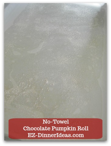 Chocolate Cake Roll | No-Towel Chocolate Pumpkin Roll - Line a half-sheet baking sheet with wax paper dusted with flour.