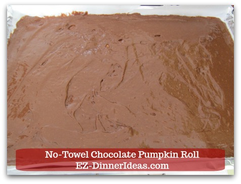 Chocolate Cake Roll | No-Towel Chocolate Pumpkin Roll - Pour in batter and spread it out evenly.