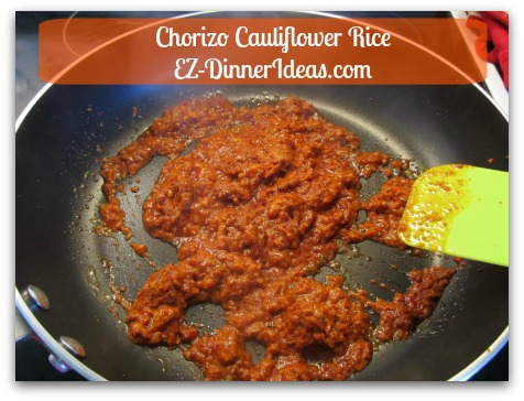 Chorizo Cauliflower Rice - Cook Chorizo at high heat.  Use spatula to break up the meat in pieces