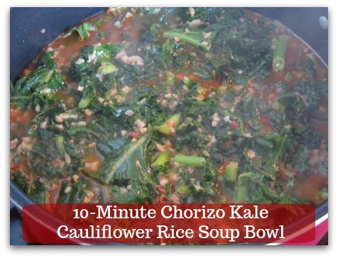 Sausage Kale Soup Recipe | 10-Minute Chorizo Kale Cauliflower Rice Soup Bowl - Add kale into the soup.  Use a spatula to press the vegetables down into the soup.