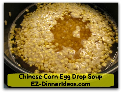 Chinese Corn Egg Drop Soup - Add frozen corn kernels once broth boiled