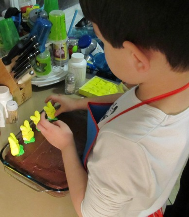 Let your little helper(s) to decorate the Easter Bunny Cake for you.  They will be very proud of themselves.