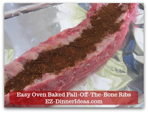 Baby Back Pork Ribs Recipe | Easy Oven Baked Fall-Off-The-Bone Ribs - 2 tbsp of BBQ rub on the back of the ribs.