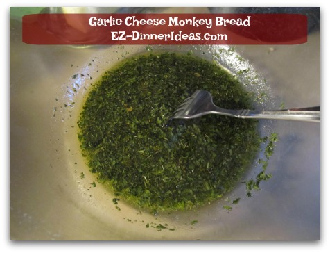 Garlic Cheese Monkey Bread - Whisk in extra virgin olive oil to form a thick paste