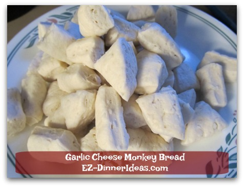 Garlic Cheese Monkey Bread - Cut each slice of store bought biscuit dough into 4-6 small pieces