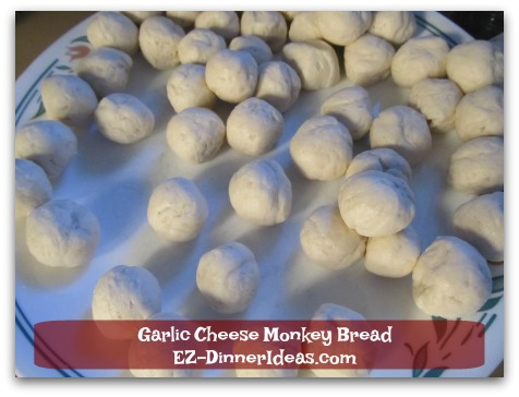 Garlic Cheese Monkey Bread - Roll each dough into a ball.  This allows the coating and cheese cover every piece evenly