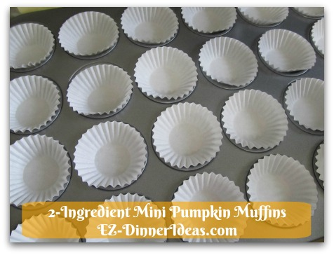 Recipe Using Spice Cake Mix | 2-Ingredient Mini Pumpkin Muffins - Line mini cupcake liners in cupcake tin