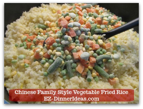 Mixed Vegetable Fried Rice | Chinese Family Style Vegetable Fried Rice - Stir in frozen mixed vegetables after egg is set and rice is golden in color.