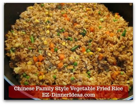 Mixed Vegetable Fried Rice | Chinese Family Style Vegetable Fried Rice - Stir in dark soy sauce to get your desired brown color in fried rice