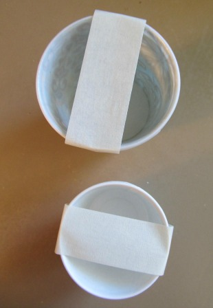 Stack 2 cups together.  Put a white painter tape across the cup, not too tight