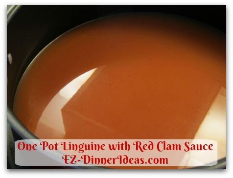 One Pot Linguine with Red Clam Sauce - More clam juice separated from 4 cans of chopped clams