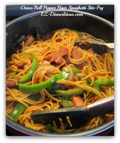 Onion Bell Pepper Ham Spaghetti Stir-Fry - Add pasta into the pot and toss to combine the onion bell pepper mixture with sauce