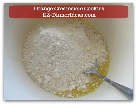 Easy Cake Mix Cookies Recipe | Orange Creamsicle Cookies - Stir in a box of cake mix.