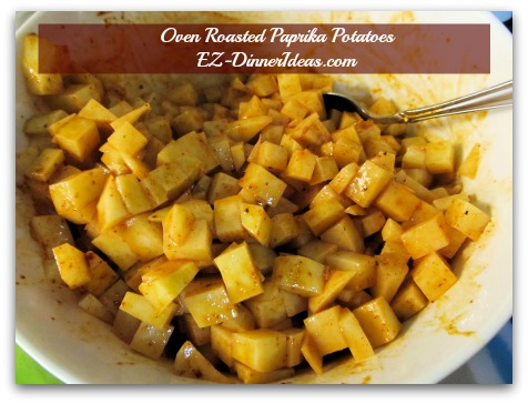 Baked Potato Hash | Oven Roasted Paprika Potatoes - Mix potatoes with oil and seasonings in a mixing bowl