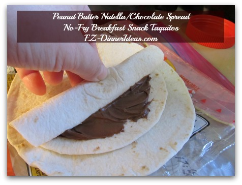 Peanut Butter Nutella/Chocolate Spread No-Fry Breakfast Snack Taquitos - As you roll it towards the other end, you will know why you need to leave the edges not covered with spread