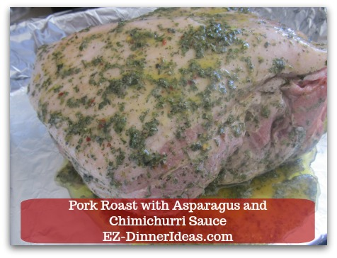 Pork Roast Recipe | Pork Roast with Asparagus and Chimichurri Sauce - Transfer meat into the pan skin side up.  Pour marinade into the pan as well.
