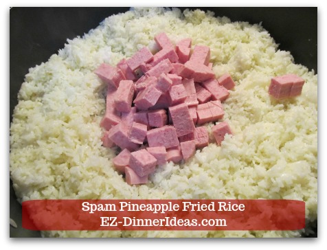 Hawaiian Fried Rice   Spam Pineapple Fried Rice - Push rice to the side and add diced Spam in the middle of the pan.