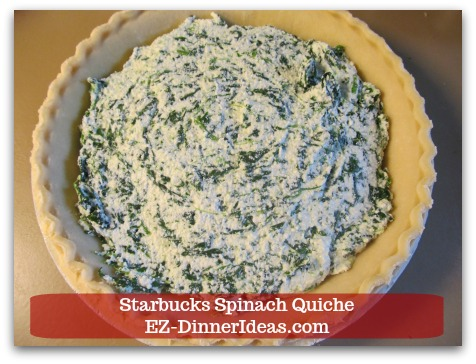 Starbucks Spinach Quiche - In one of the two pie crusts, add spinach, ricotta cheese and egg filling.
