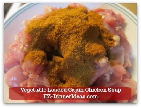 Kale Chicken Soup | Vegetable Loaded Cajun Chicken Soup - Add 1 tbsp Cajun seasoning and toss to coat.